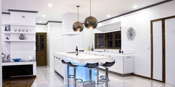 light-infused-modern-kitchen-stylish-white-kitchen-island-design-600x300